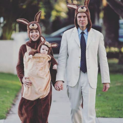 Alyson Hannigan with her husband and daughter during Halloween.