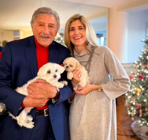 A photo of Tony Bennett and Susan Crow holding their pet dogs.