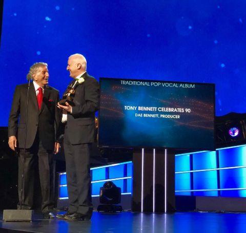Dae Bennett receiving an award alongside Tony Bennett.