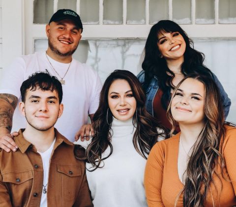 Chiquis with her four siblings.