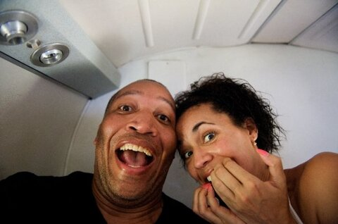 Fredricka and John Glenn on a plane.