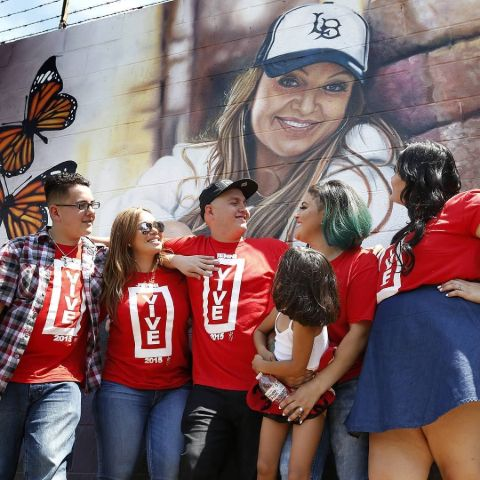 Michael's Family in front of Jenni Rivera mural.