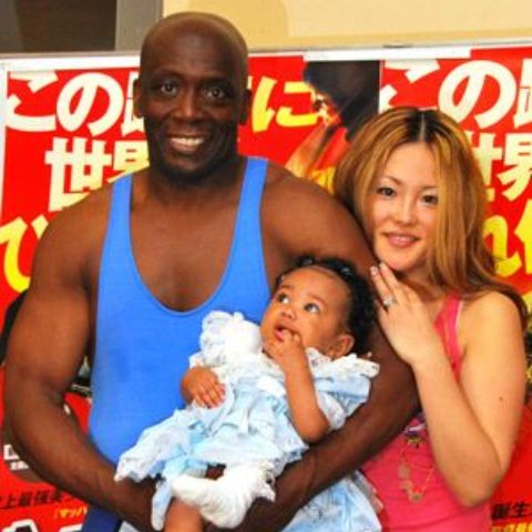 Billy Blanks with his current wife, Tomoko Sato, and daughter.